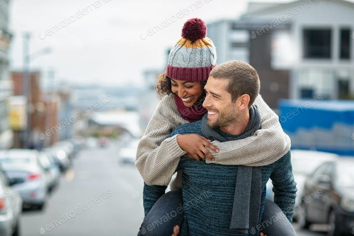 Multiethnic couple having fun in winter