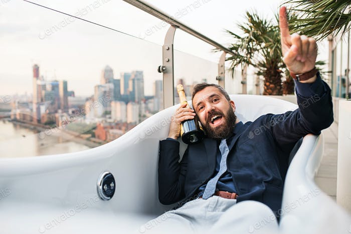 Businessman lying in empty jacuzzi, London view panorama in the background.