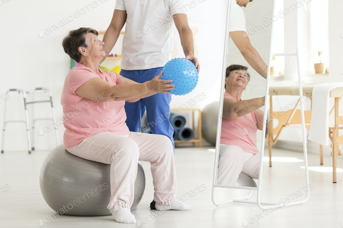 Senior woman on exercise ball
