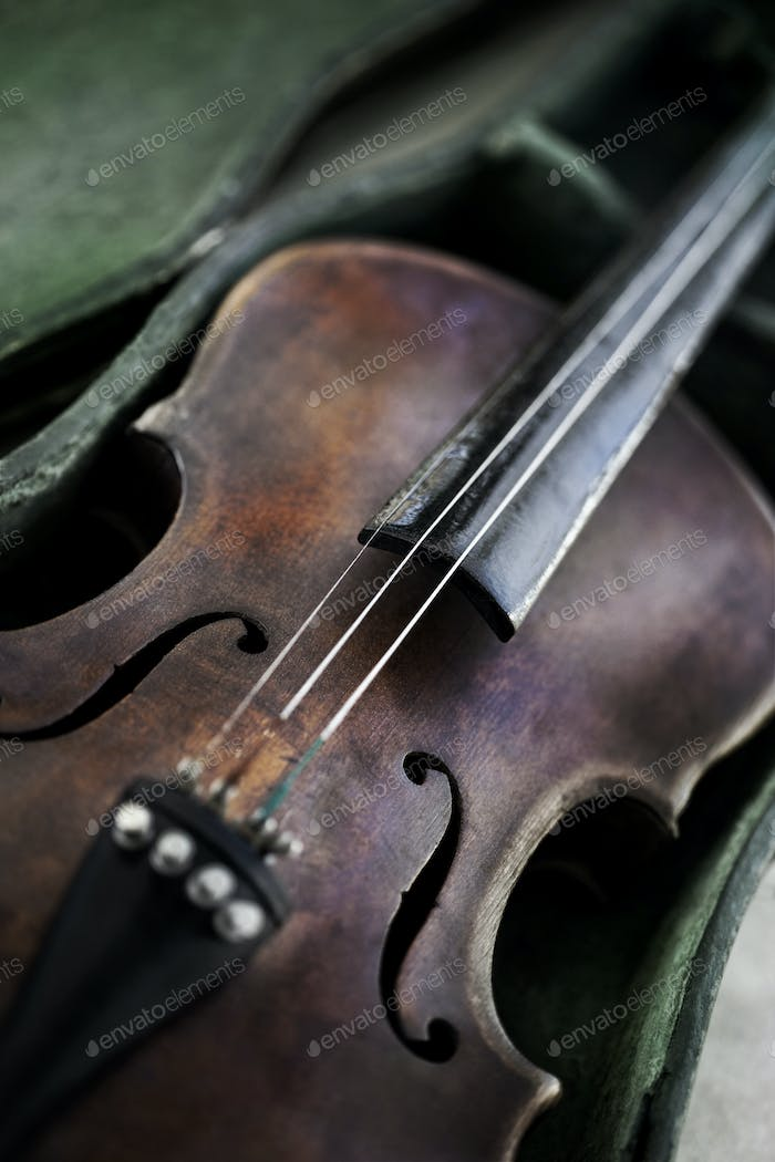 Old weathered violin on a flea market