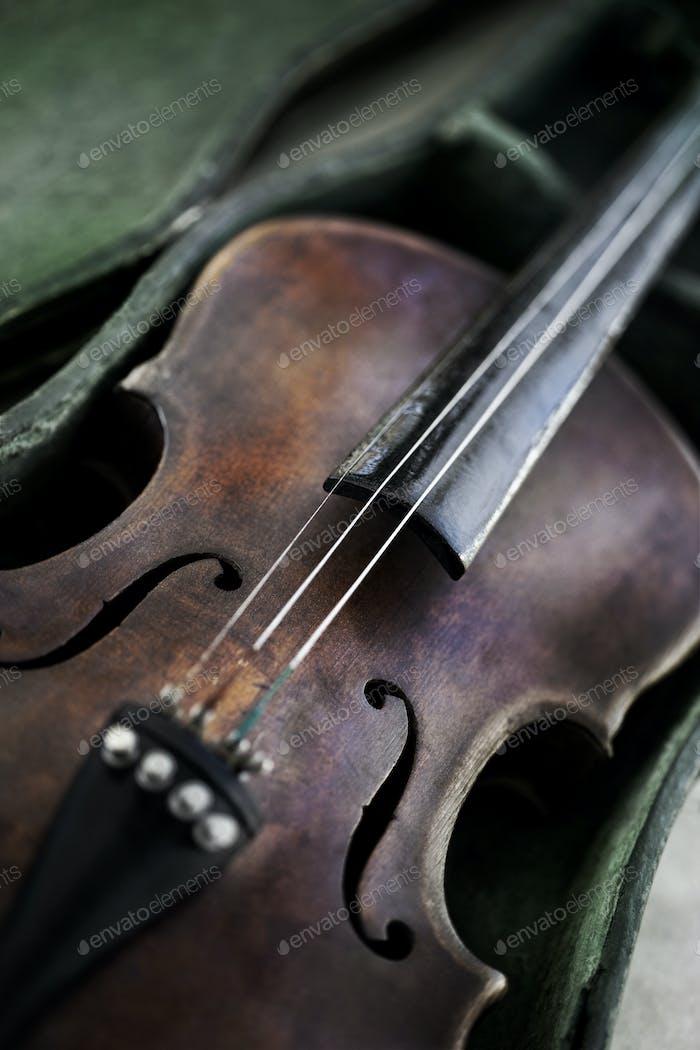 Old weathered violin on a flea market
