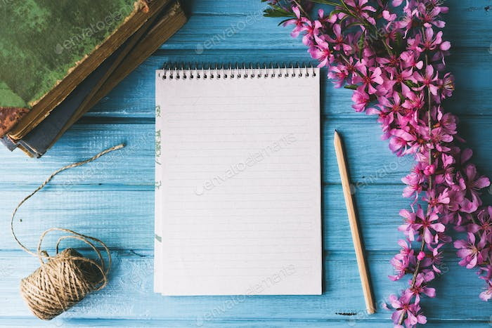 Thumbnail for Blank notebook and wild flowers on blue wooden background. Concept flowers of spring,