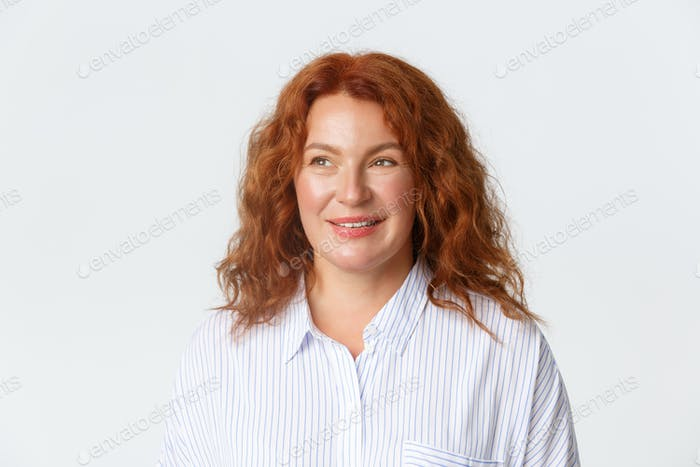 People, emotions and lifestyle concept. Dreamy and happy middle-aged redhead woman in blouse smiling