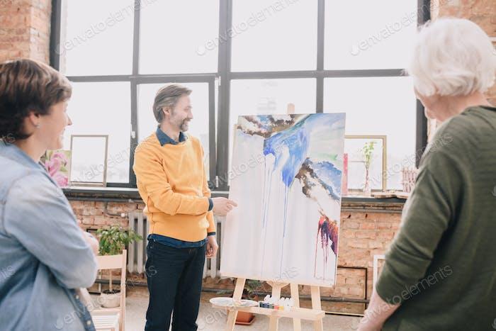 Mature Artist Presenting Painting