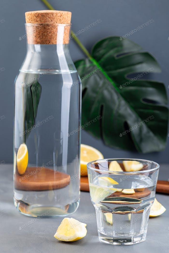 Optical illusion lemon distorted through the glass of water, lemon water or lemonade
