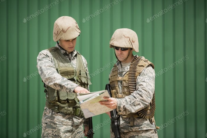 Soldiers having discussion over map