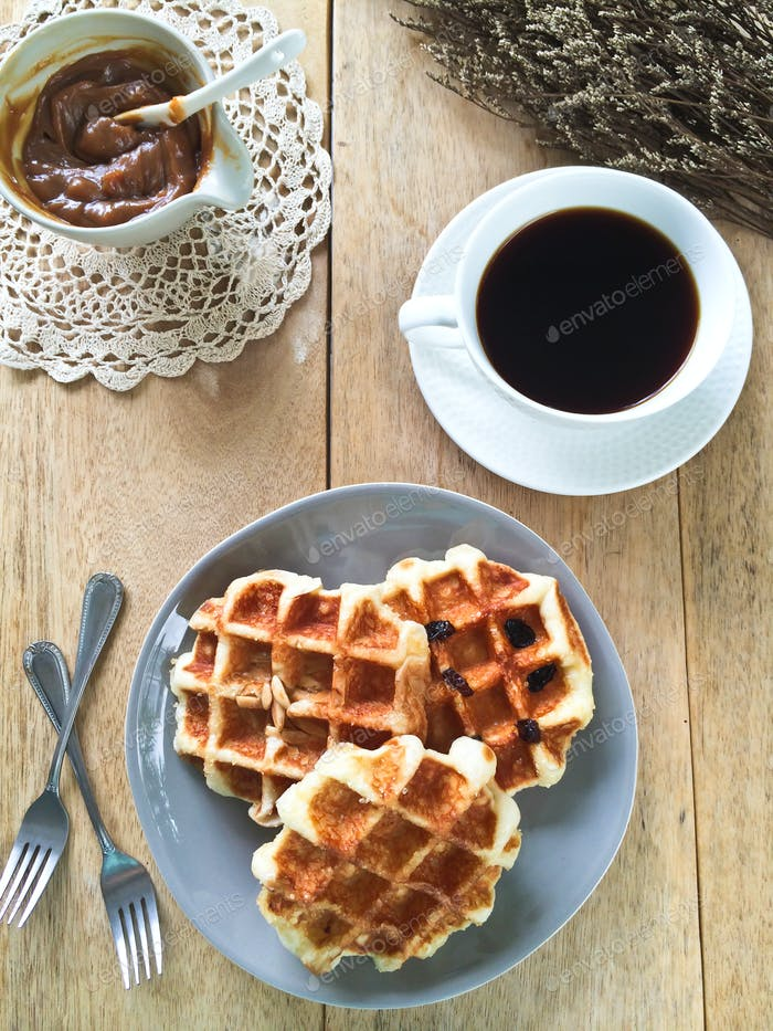 Waffle with caramel sauce by coffee