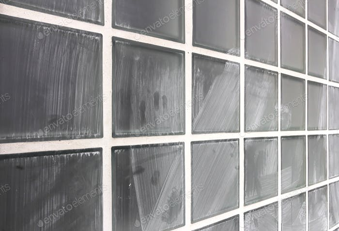 Wall of glass dirty blocks