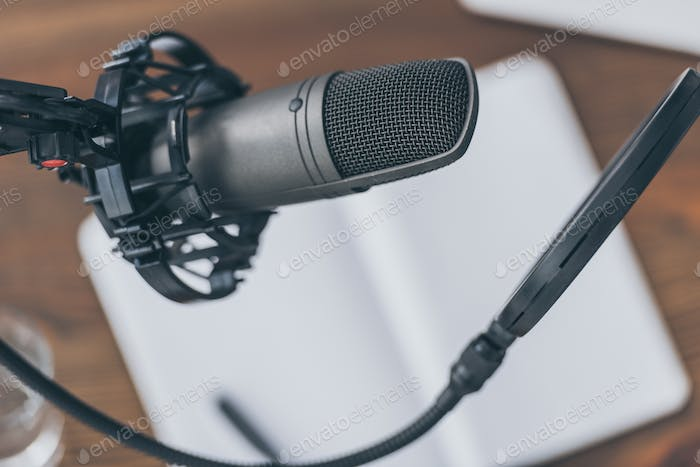 selective focus of professional microphone in broadcasting studio