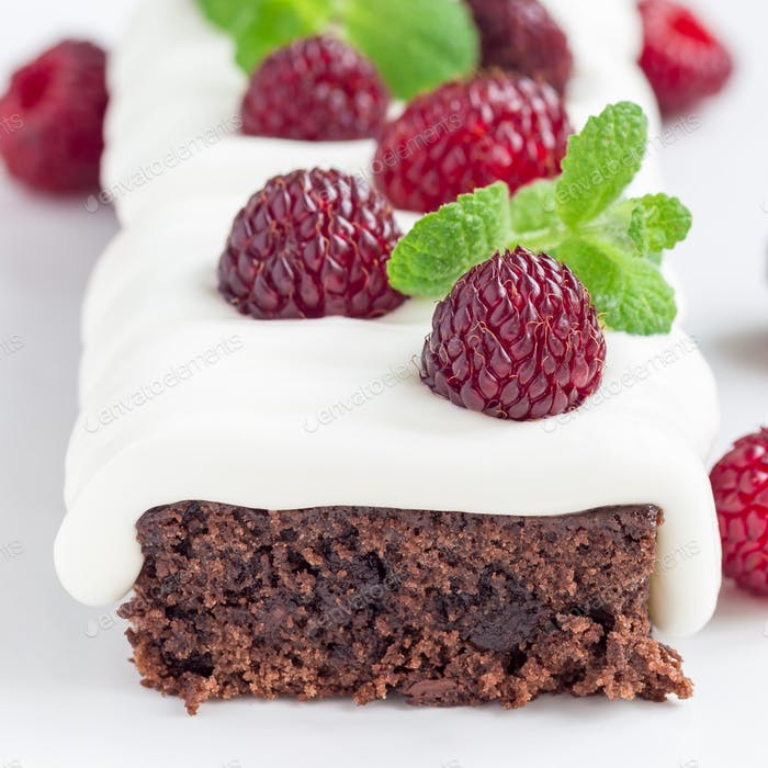 Homemade brownies with cream cheese frosting and raspberry, square