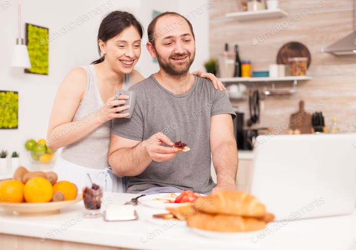 Couple talking online with family