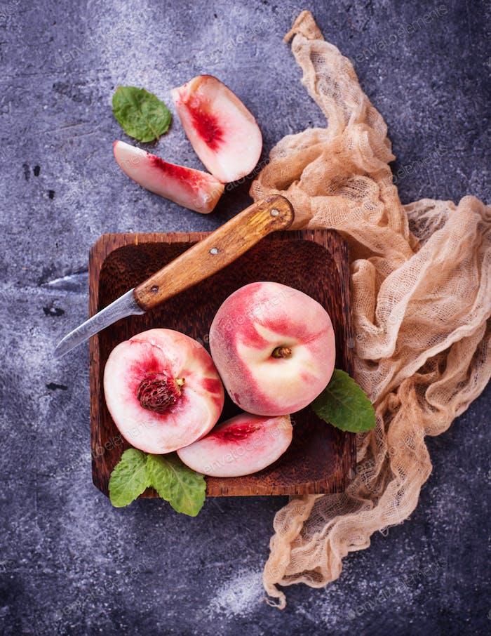 Fresh ripe peaches on concrete background