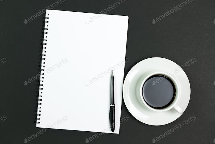 Blank notepad with coffee