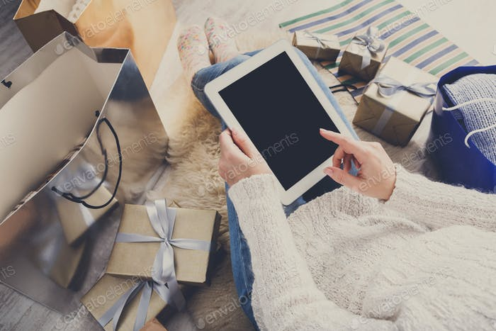 Woman christmas shopping online, above view