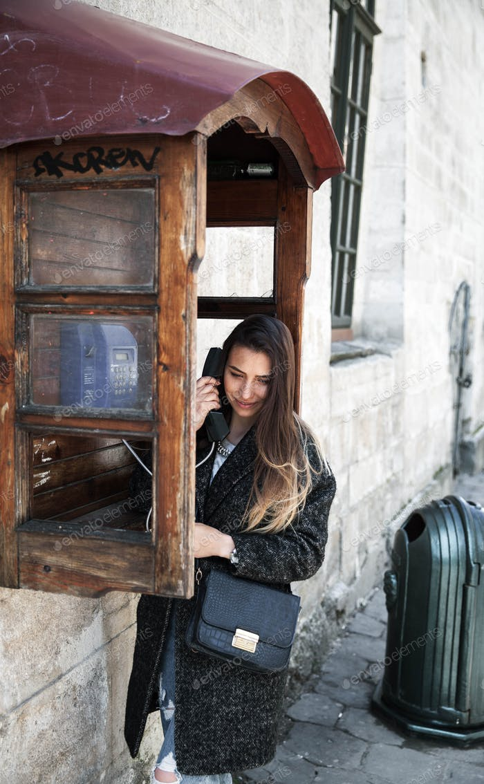 Beautiful girl in the phone booth.