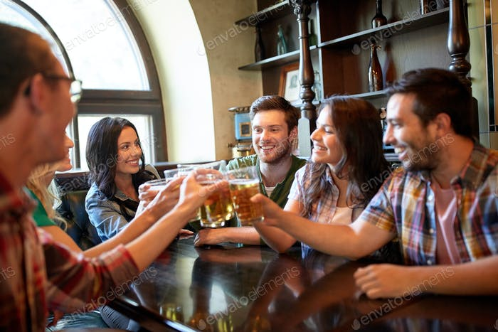 happy friends drinking beer at bar or pub