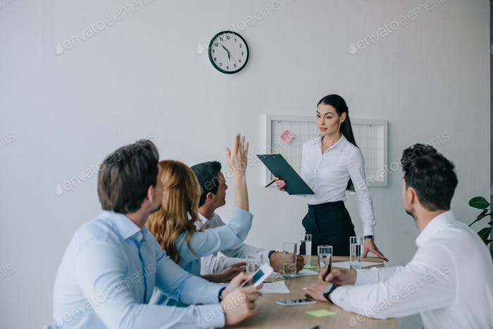 business coworkers having business training at workplace in office