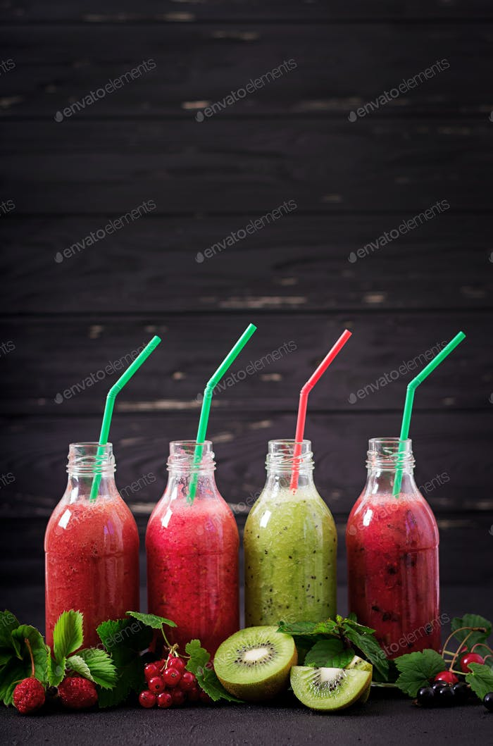 Fresh healthy smoothies from different berries on a dark background