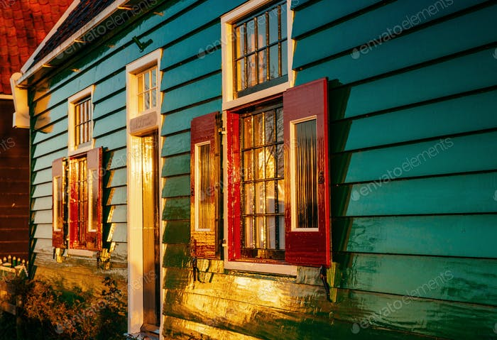 Comfortable houses at sunset. Beautiful traditional wooden  in Holland