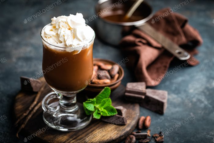 Thumbnail for Iced cocoa drink with whipped cream, cold chocolate beverage, coffee frappe on dark background