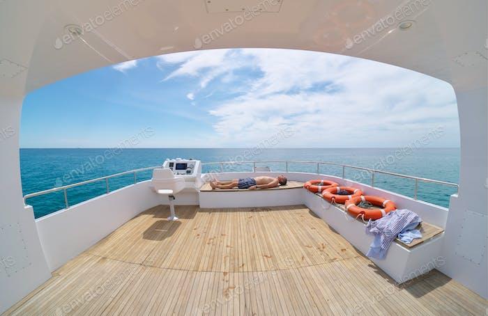 Man relax on yaht. Pleasure recreation on sea.
