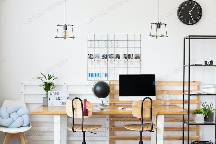 Black clock in white office