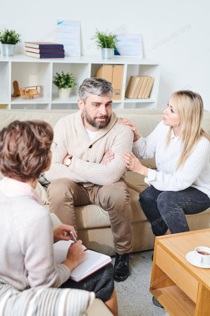 Husband being distant at therapy session with wife