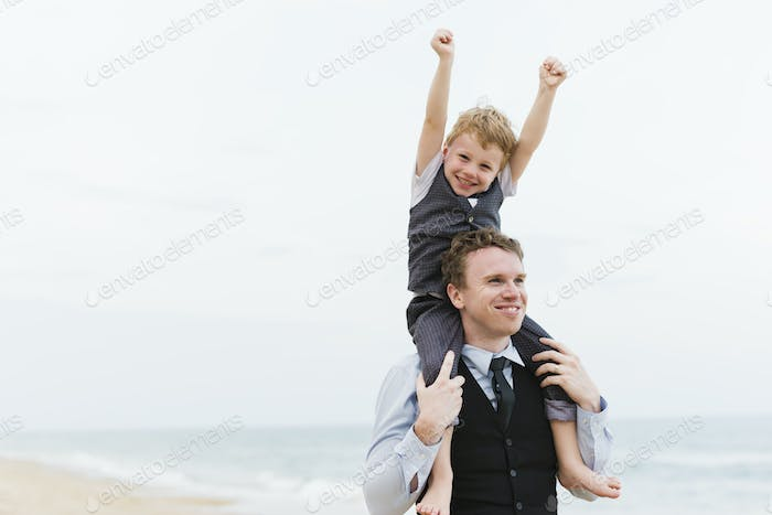 Cheerful family at beach wedding ceremony