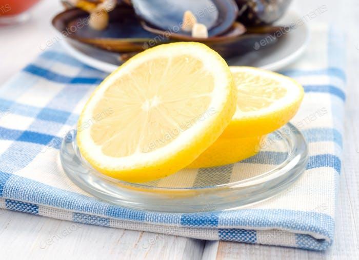 wheels cut lemon in glass dish