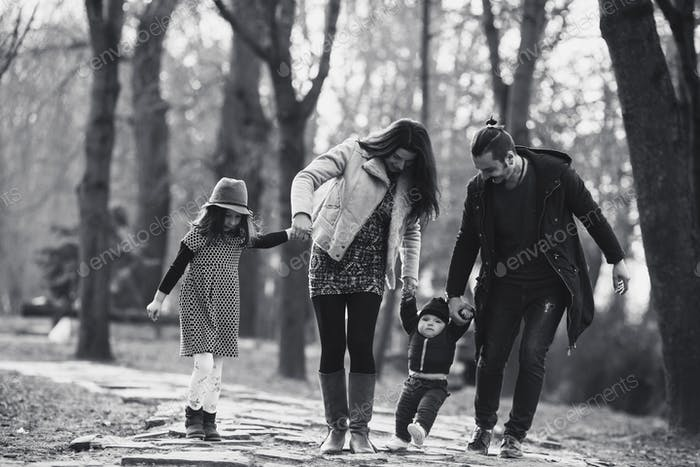 happy family walking in the autumn park