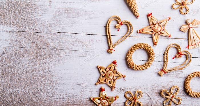 Christmas straw decoration. Studio shot.