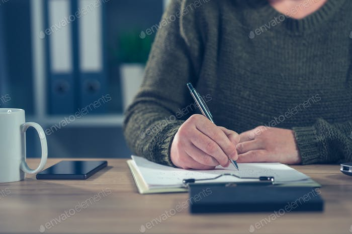 Female freelancer doing paperwork