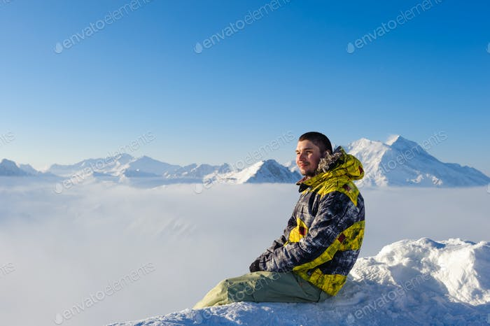 Man at mountains in clouds