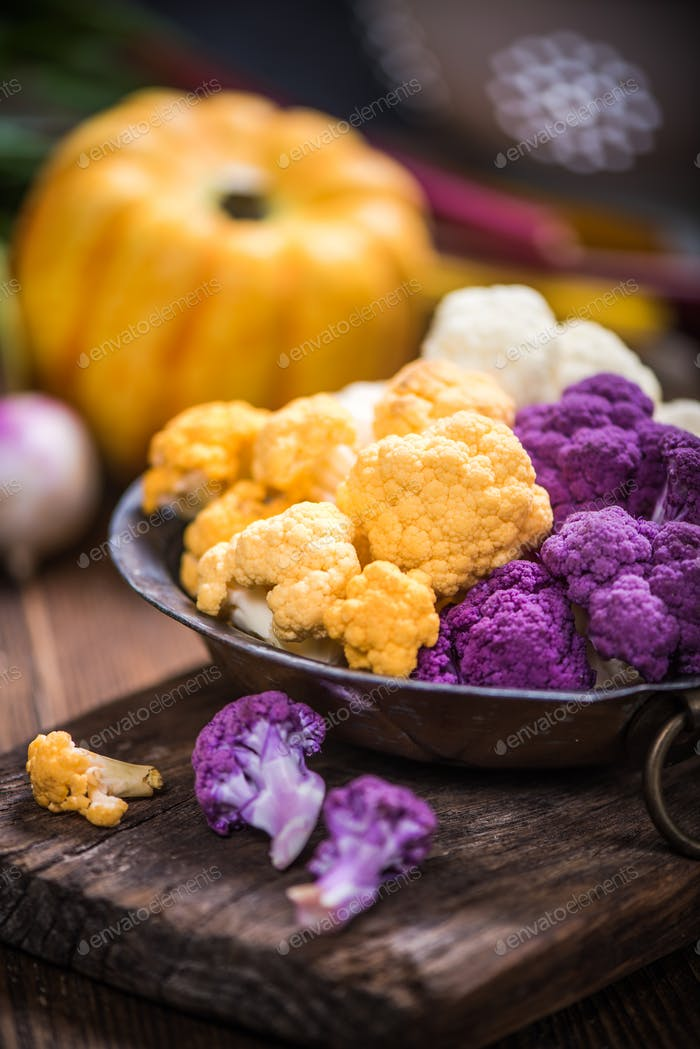 Colorful cauliflower in rustic bowl