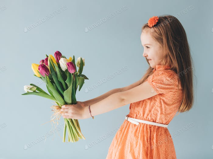 Young child holding a bunch of fresh flowers