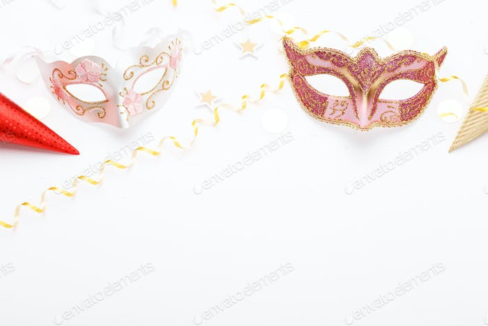 Carnival mask and confetti on white background