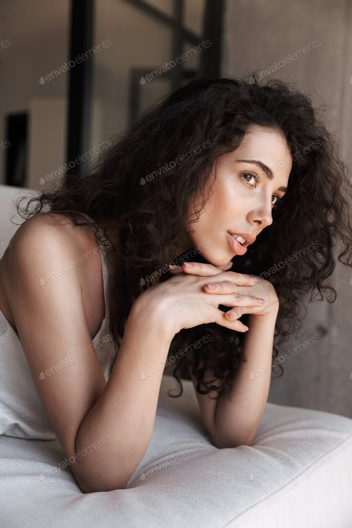 Photo of beautiful woman 20s with long curly hair wearing silk l