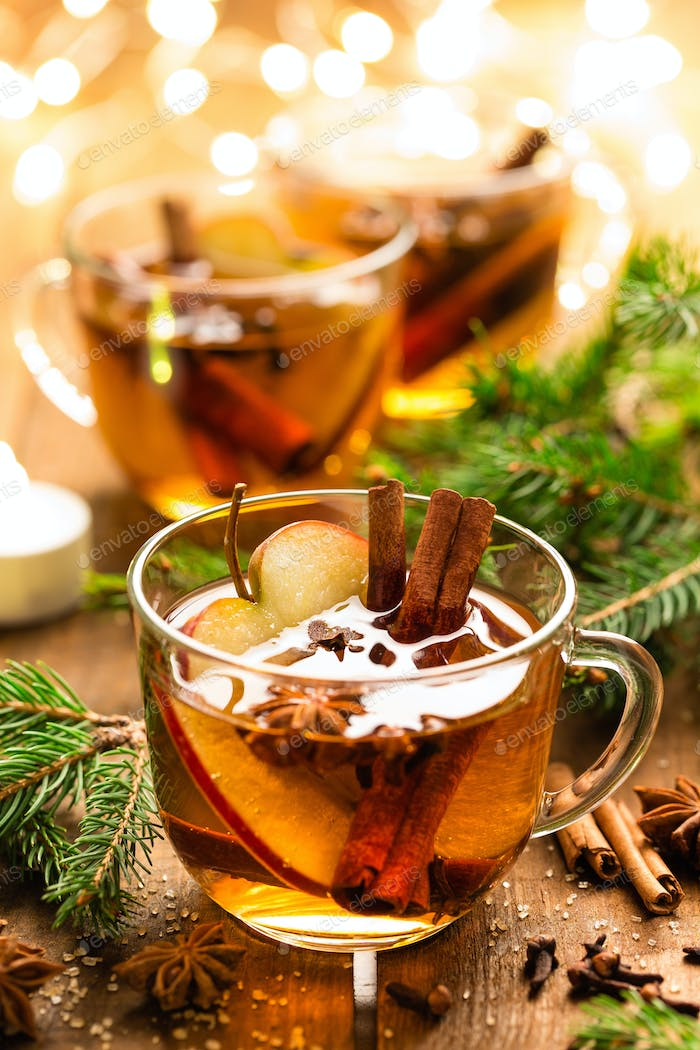 Mulled cider with cinnamon, cloves and anise. Traditional Christmas drink