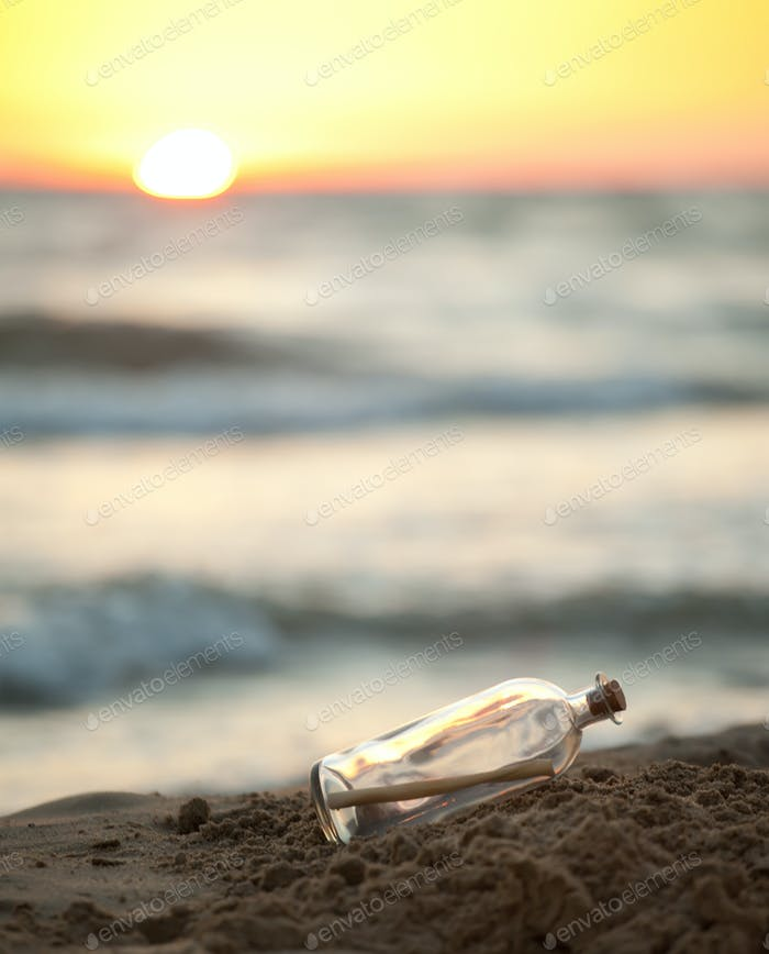 Message in a Bottle on sea beach