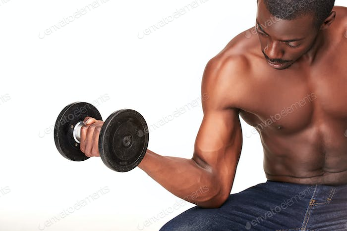 Strong and muscular guy with dumbbell isolated on white background