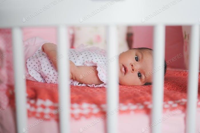 cute newborn baby lying in bed
