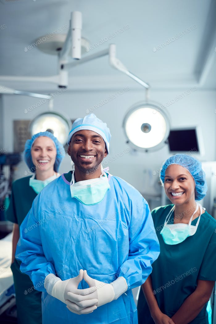 Portrait Of Multi-Cultural Surgical Team Standing In Hospital Operating Theater