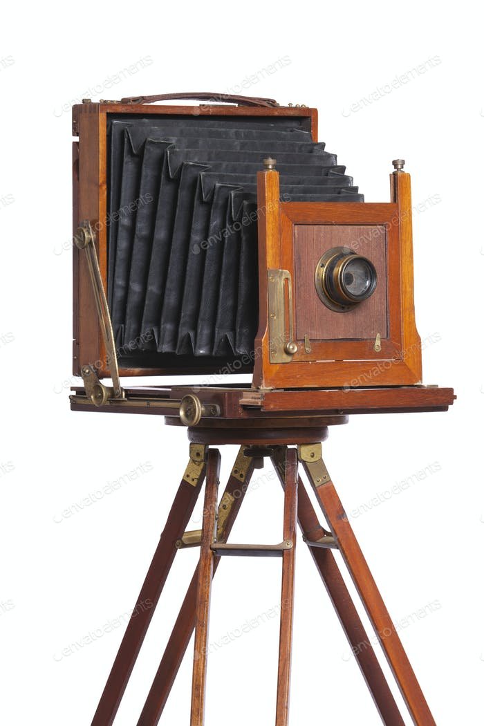 Antique bellows style camera on a tripod isolated on white