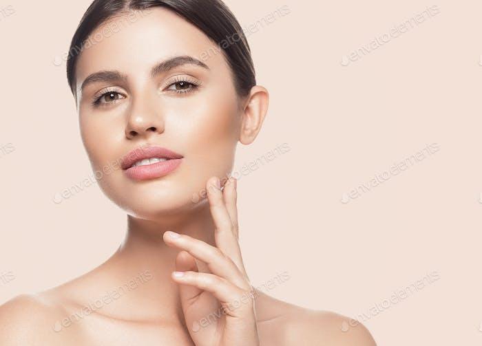 Beauty skin woman face healthy skin beautiful model close up face natural makeup brunette hair.