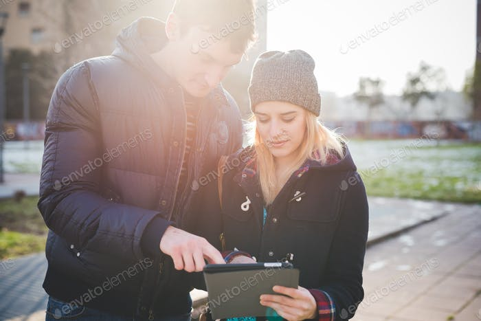 Half length of young couple lovers authentic using tablet connec