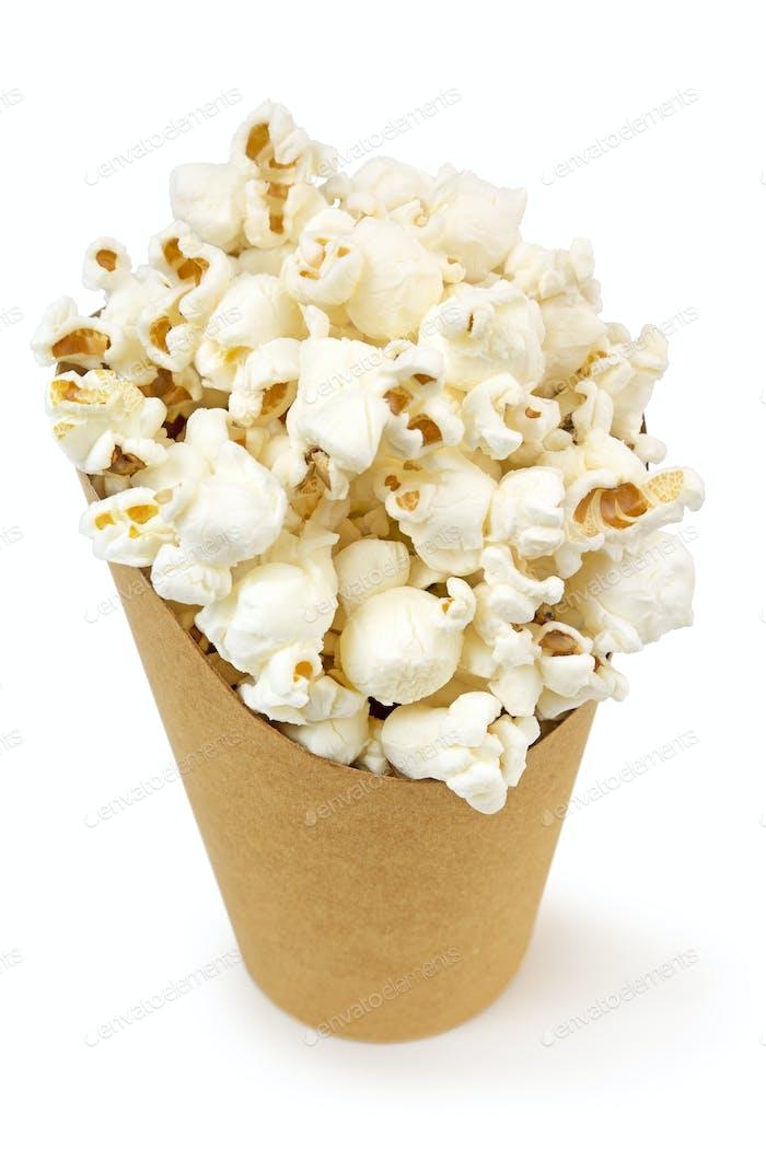cardboard bucket full of popcorn isolated on white
