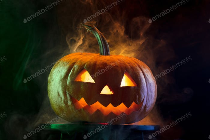 Halloween pumpkin head jack lantern with scary evil face