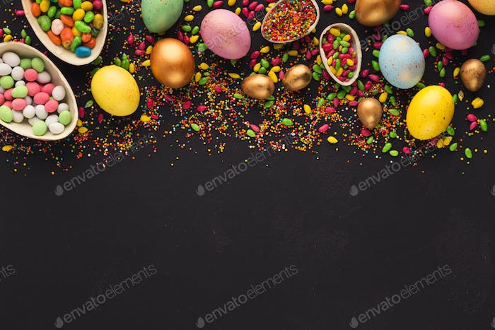 Border of colored and chocolate eggs