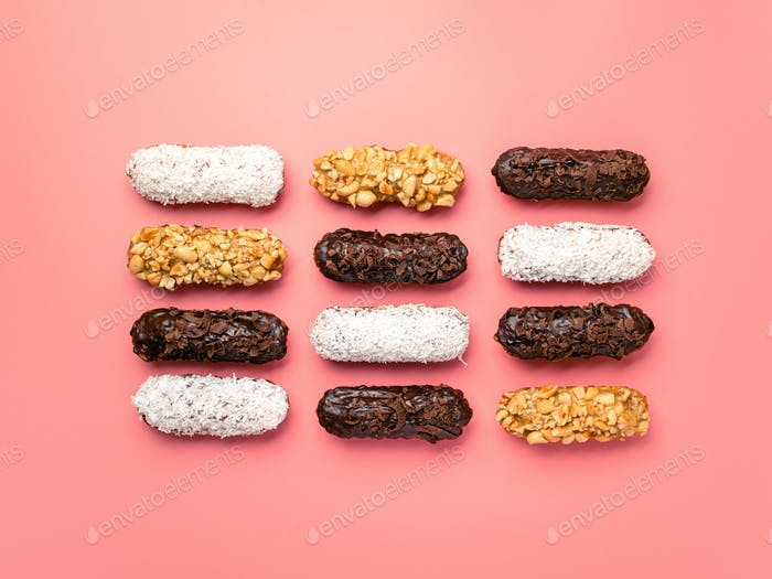 eclairs or profitroles on pink background