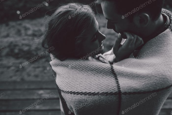 Young couple wrapped in plaid